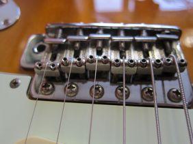 12 - new strings on bridge